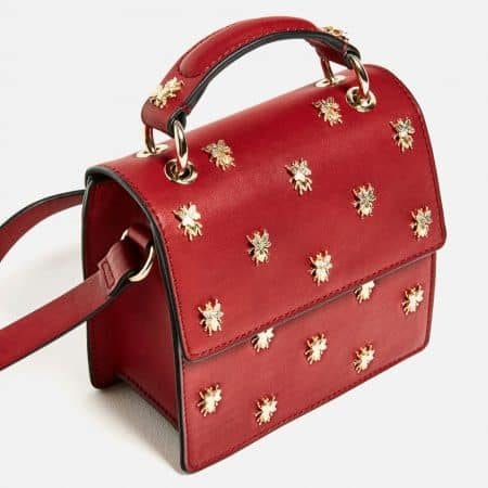 Red box bag with metal embellishments