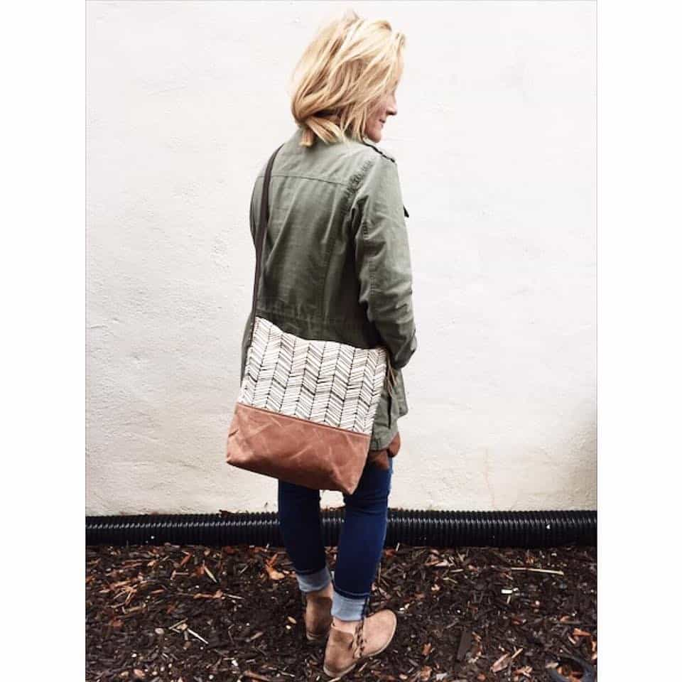 alpharetta shopping guide - sis & moon's - model wearing green jacket
