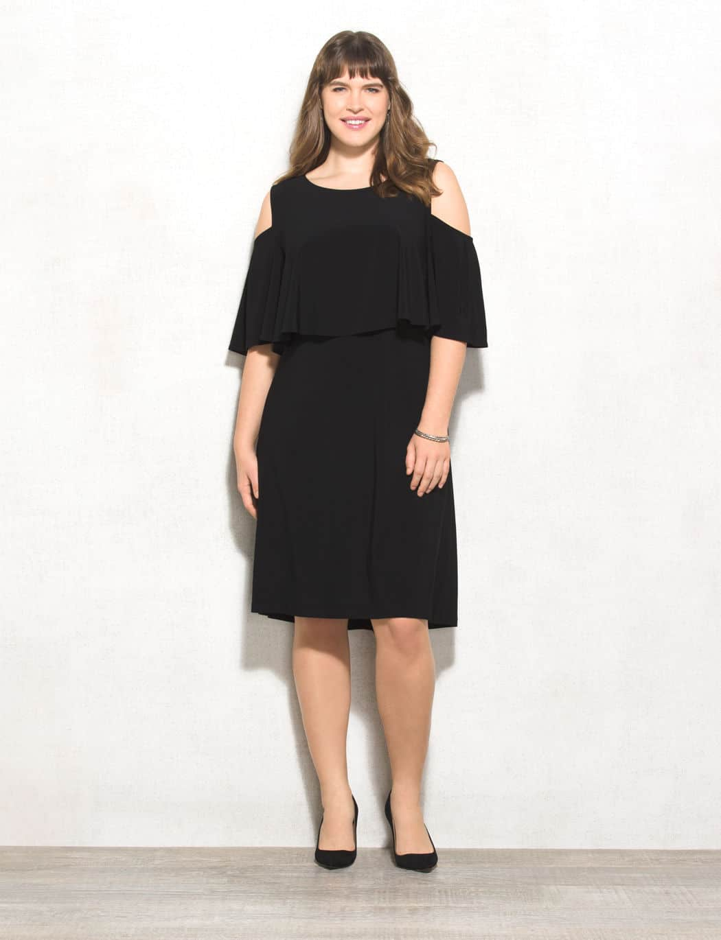 plus-size dresses - woman wearing black, off the shoulder holiday dress