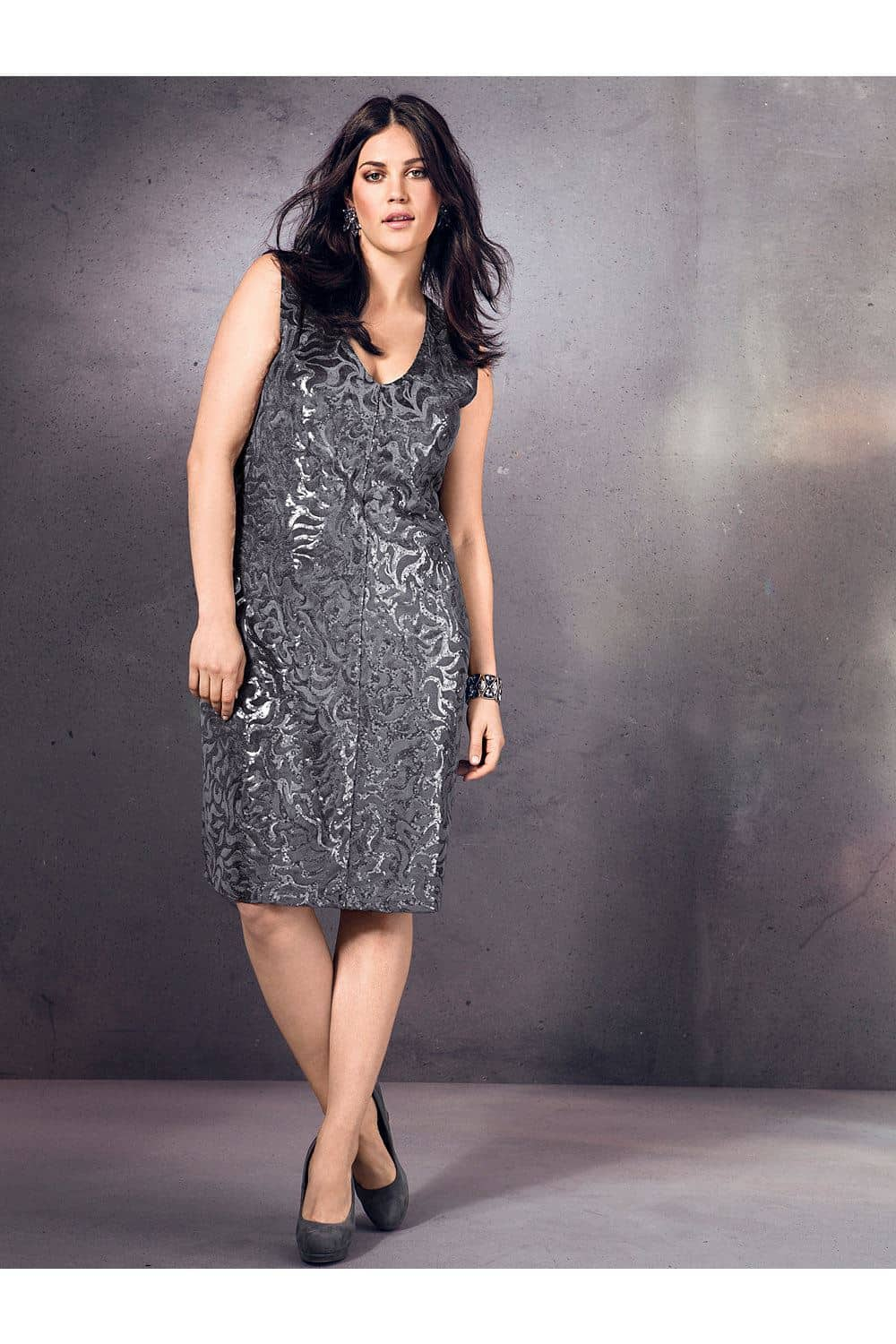 plus size dresses: woman wearing grey sequined dress