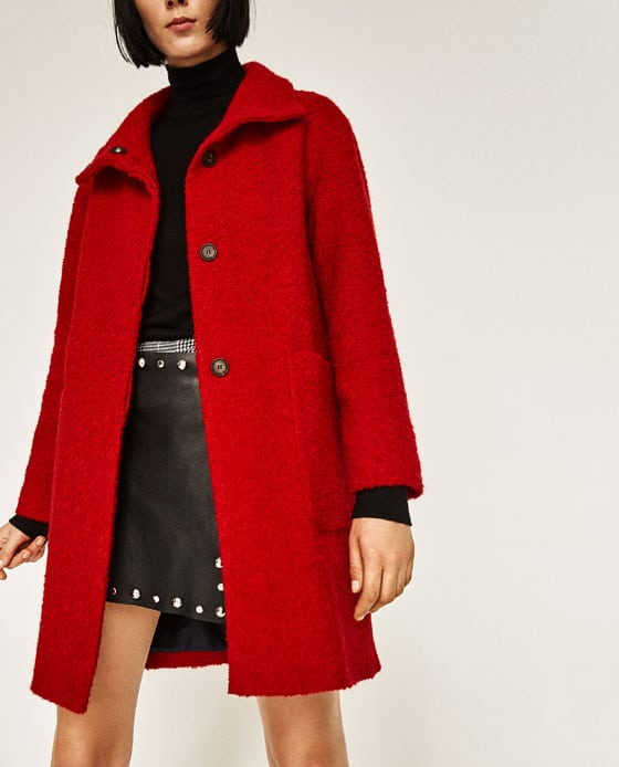 woman wearing red a line coat
