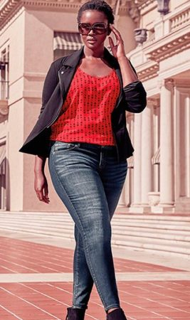Woman wearing skinny jeans and red sweater