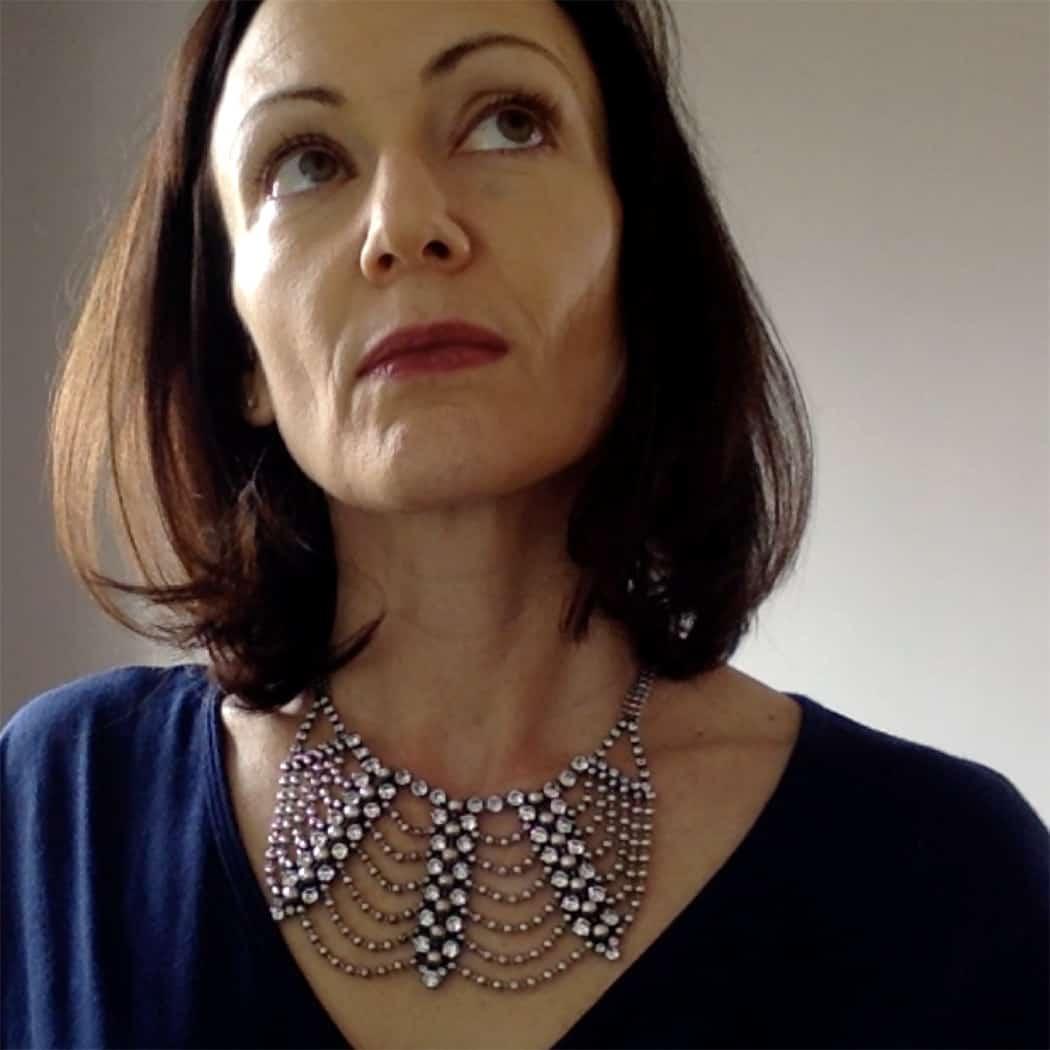 Catherine Brock of Budget Fashionista wearing Dannijo Marina Bib necklace