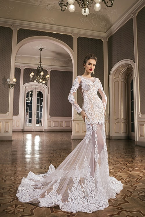 Woman wearing floor-length bridal gown with train