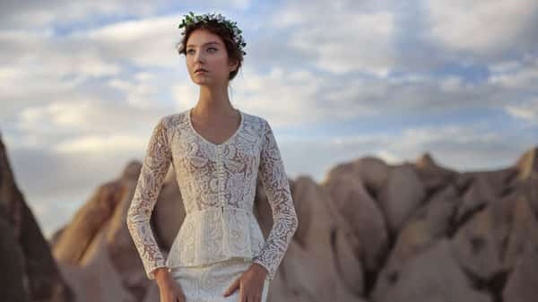 Woman wearing bridal gown outside