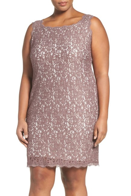 Model wearing plus-size, sleeveless lace dress