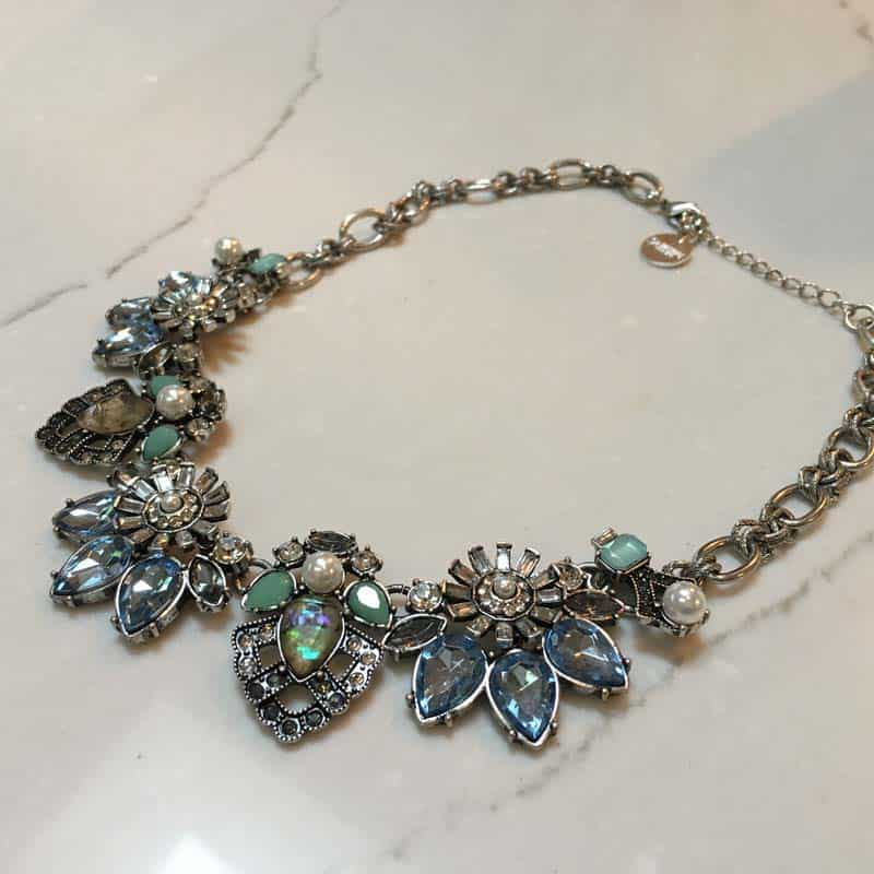 Close-up of floral bib necklace from Three Sisters
