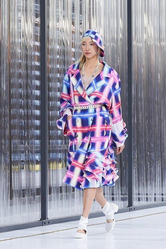 Hot summer fabrics - model wearing bright pink and blue dress