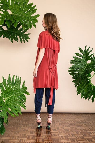 Summer fabrics trends - coral colored cardigan in a mesh fabric