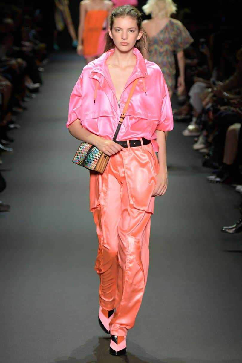Summer fabrics trends - runway model wearing brightly colored nylon outfit