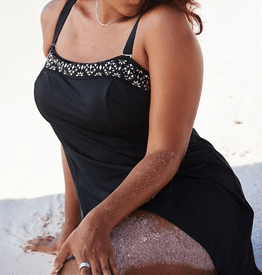 Black, plus-size, one-piece swim dress with studding detail at the chest
