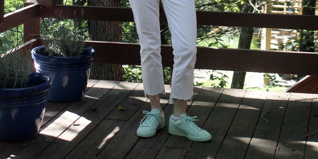 close-up of my DIY step hem white jeans