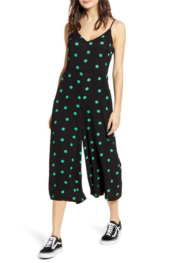 Black jumpsuit with green polka dots