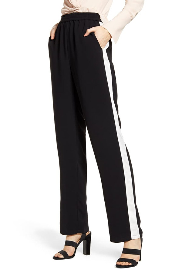 Black track pants with white side-stripe