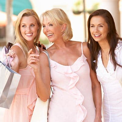 Three women of different ages shopping together.