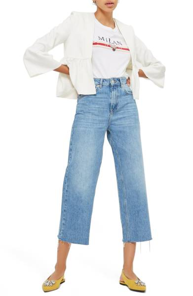 White cropped jacket pairs with cropped denim