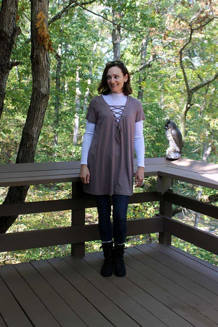 Shift dress worn as a tunic over jeans and a long-sleeved top