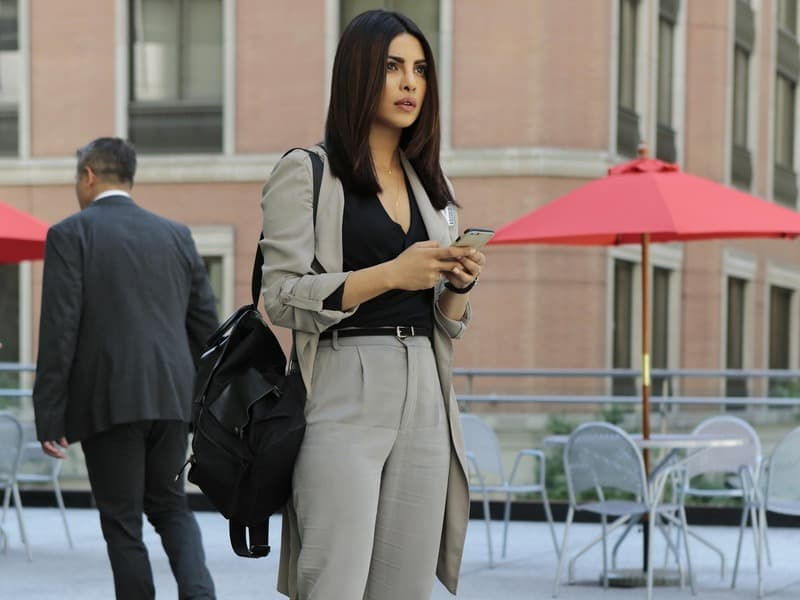 Quantico star showing offer her fashion sense in a power suit