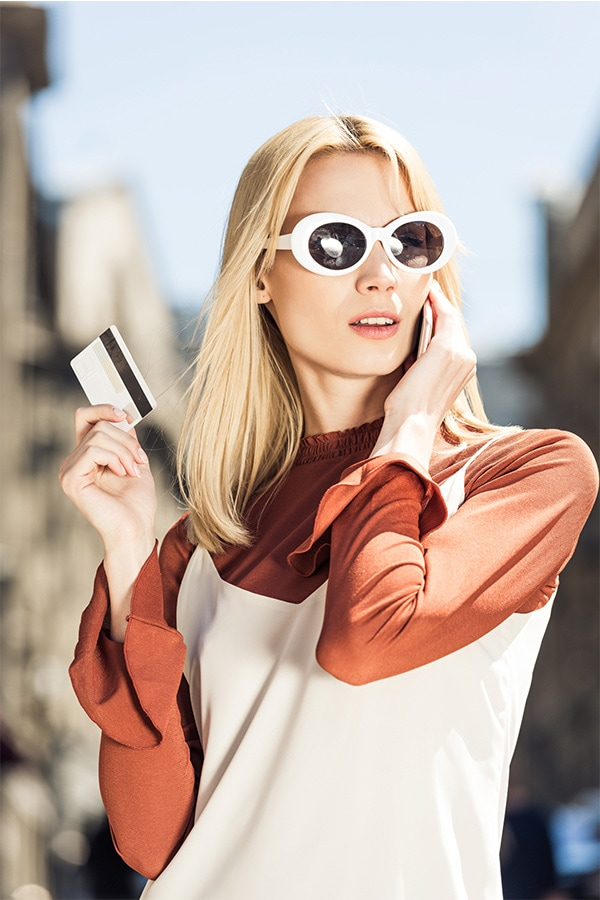 Stylish woman with credit card.