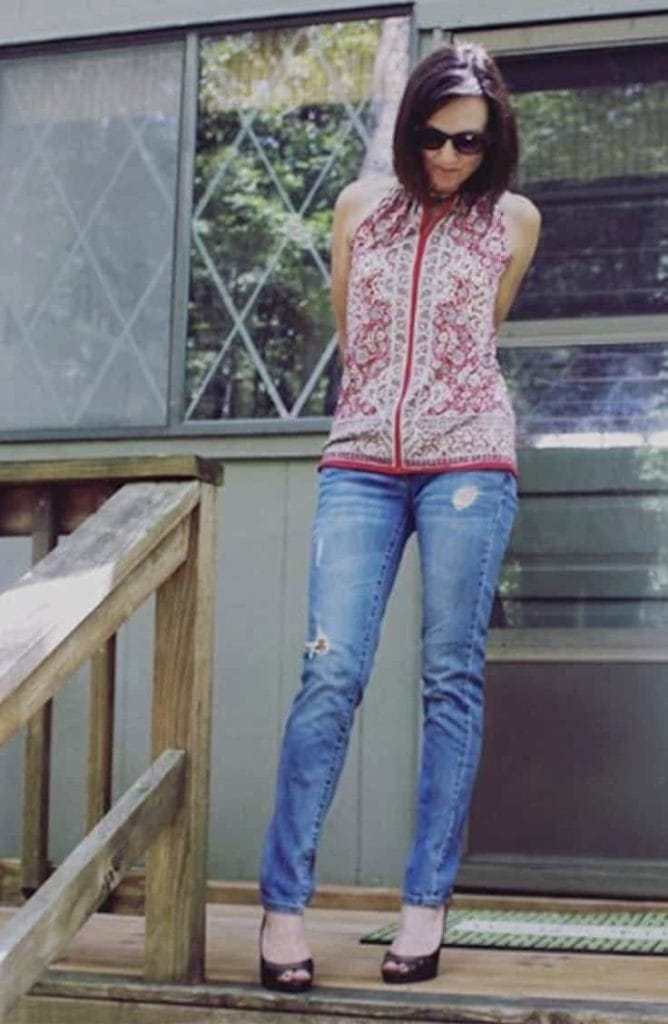 Distressed denim jeans with heels and patterned top