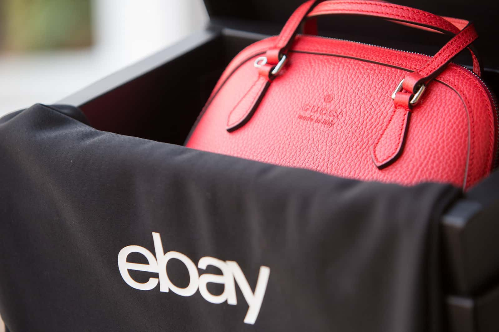 red handbag in an eBay package