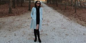 Catherine Brock, Budget Fashionista wearing powder blue trenchcoat and black cowl-neck sweater dress