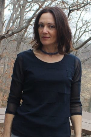 Catherine Brock wearing Swarovski double bracelet that also works as a choker