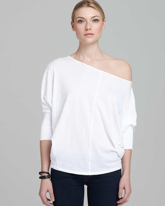 White dolman sleeve top with asymmetric neckline