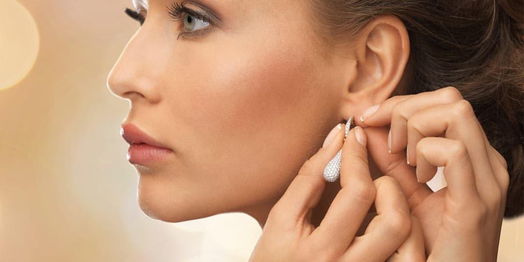 Woman wearing expensive earrings