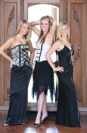 3 girls dressed up for prom