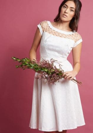 White short-sleeved date night dress with sheer detail