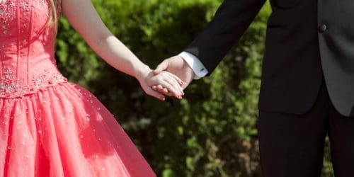 Prom dates holding hands