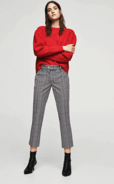 Checked crop pants with red sweater and black boots