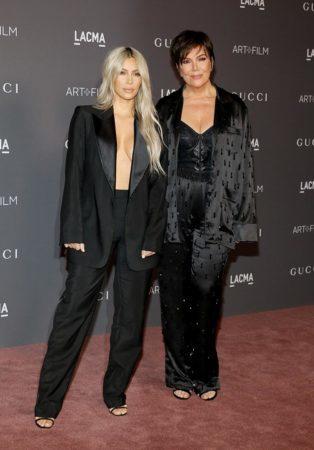 Kris Jenner and Kim Kardashian wearing all black
