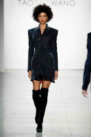 Runway model wearing navy blue suit