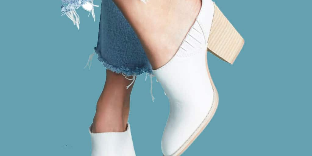 White mules with fringed hem jeans