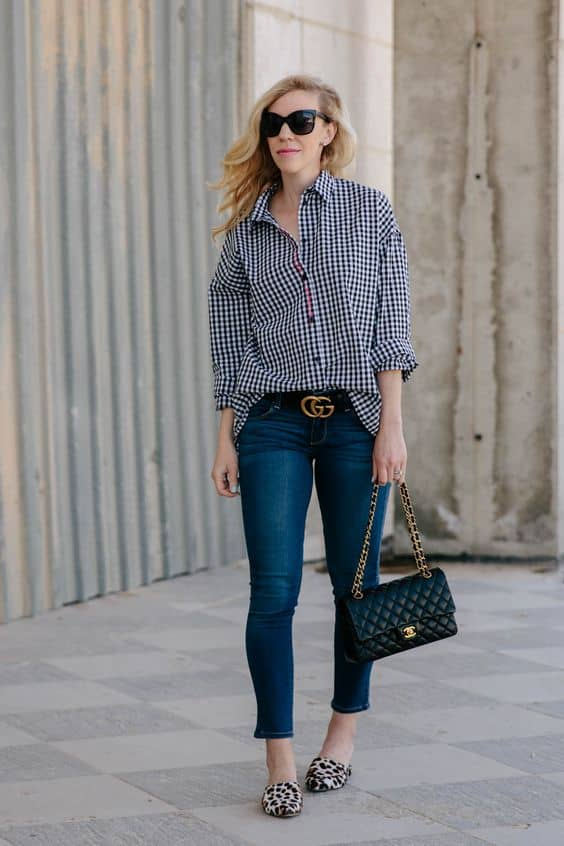 Woman wearing checked top and mules