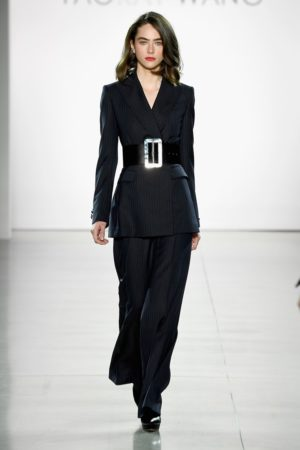 Dark suit with wide belt by Taoray Wang