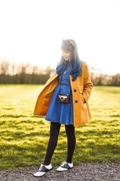 Woman wearing yellow jacket, denim dress
