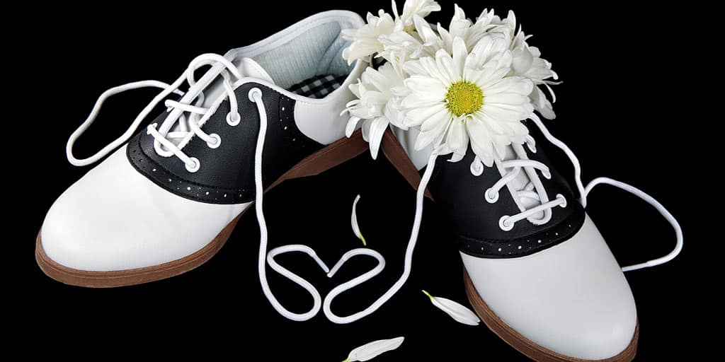 Pair of saddle shoes with a daisy