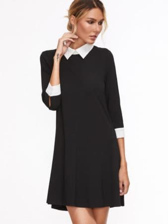 Black swing dress with white cuffs and white collar