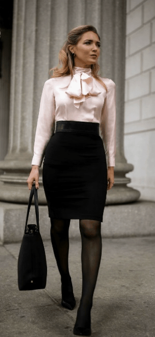 Woman wearing pencil skirt, blouse and carrying a canvas tote