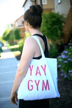 Girl holding canvas tote bag as gym bag