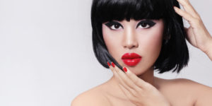 Woman with cat-eye makeup and bold red lips