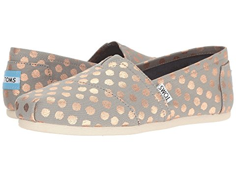 Toms flats with gold polka dots