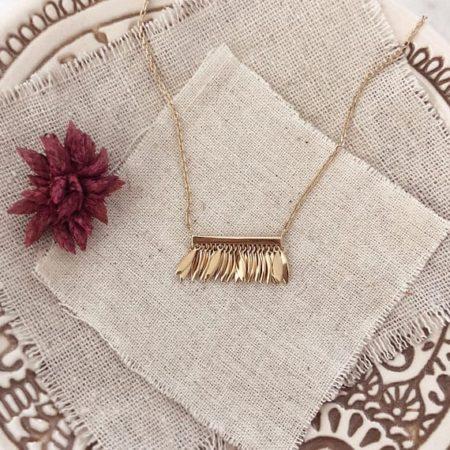 Gold fringe style necklace pendant