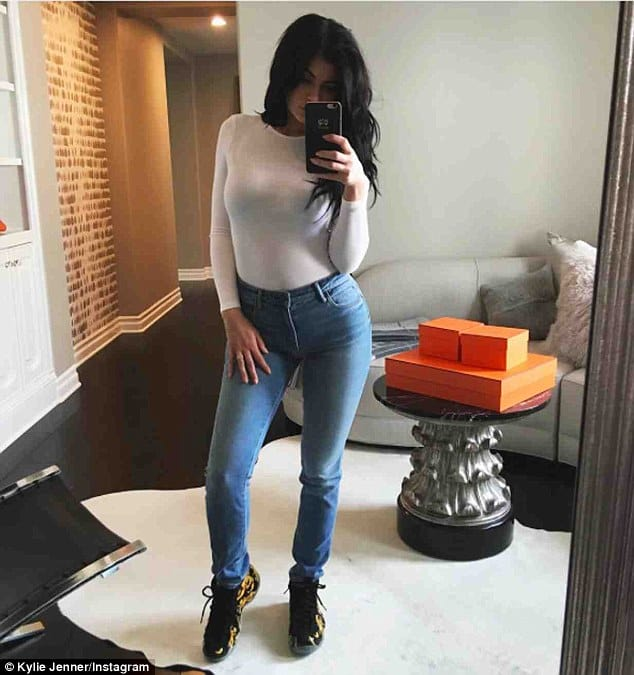 Kylie Jenner wearing bodysuit and jeans.