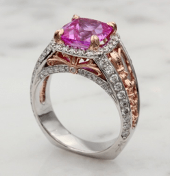 Custom ring with two-tone metal and a pink stone