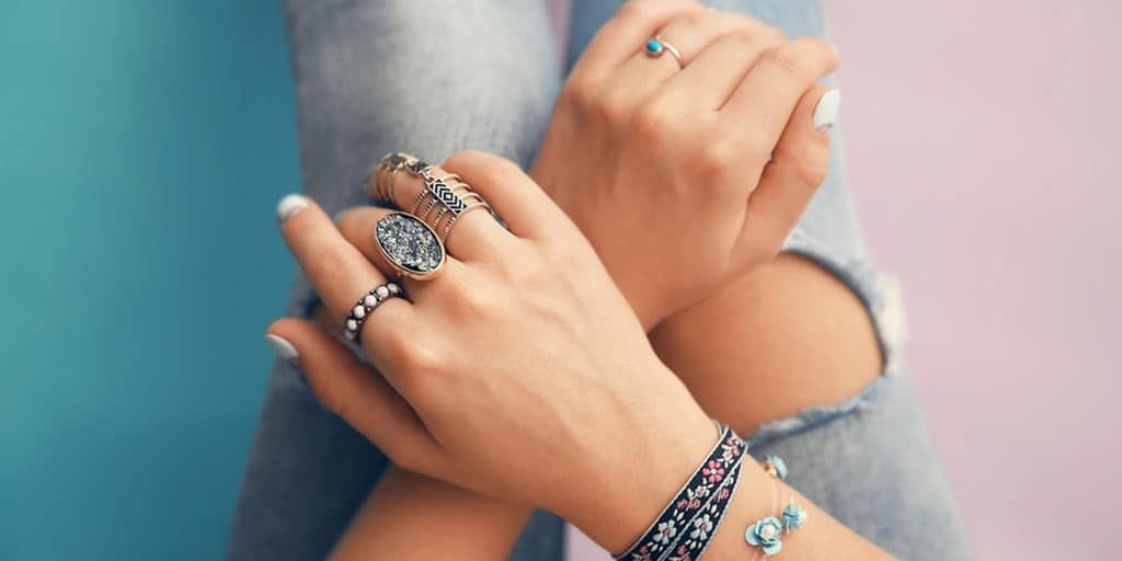 Girl wearing trendy jewelry: rings and bracelets