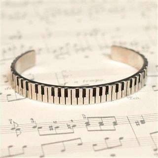 Cuff bracelet with piano keys design